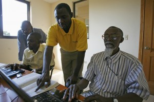 The Haitian Creole Study Bible team in their office at the Haitian Bible Society. Left to right: the Rev Willio Blanc, the Rev Manassé Pierre-Louis, the Rev Jean-Berneste Ambéau and the Rev Pauris Jean-Baptiste (coordinator). November 2010, Port-au-Prince, Haiti. (Project 77514)